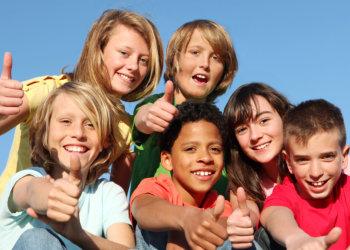 Kids raising their thumb fingers